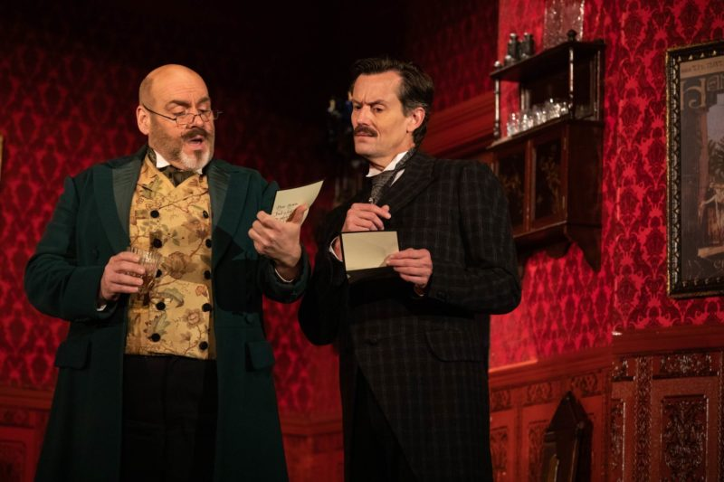 The new managers of the Paris Opera House read a threatening note from The Phantom of the Opera